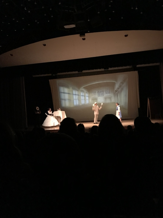Stage performance of Beauty and The Beast with Mrs. Potts, Chip, Lumiere, and Belle.