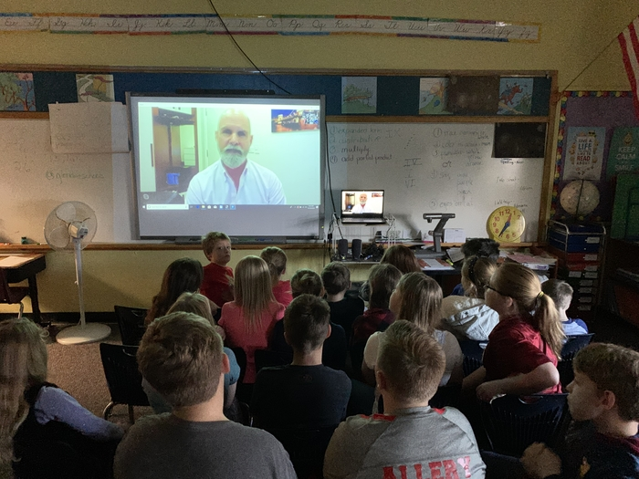 Class on Skype call with author.