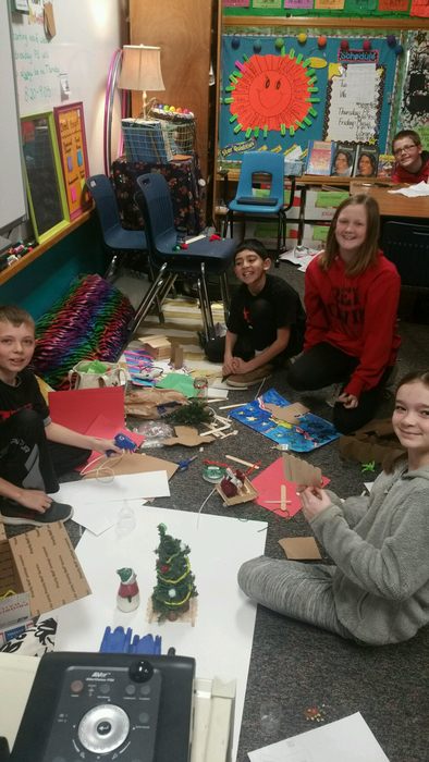 Students on the floor crafting Santa's workshop.