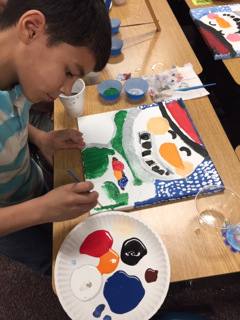 Student painting a snowman.