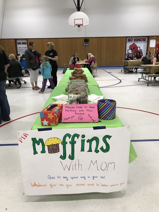 Table with a sign for Muffins with Mom