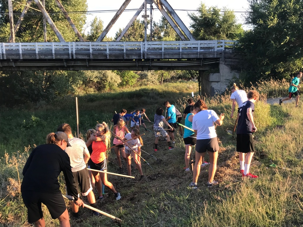 Cross Country athletes cleaning up (GPSServes)
