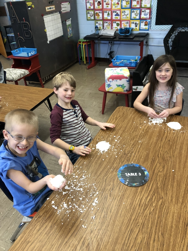 First graders making snow